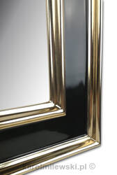 Mirror in black frame gilded with genuine 22ct gold leaf